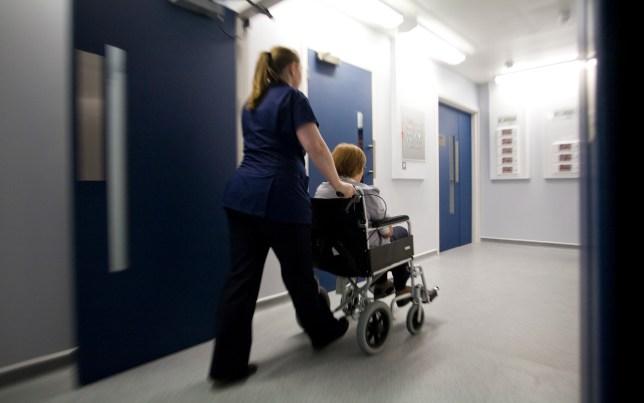 A nurse pushing a patient