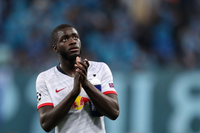 RB Leipzig defender and Arsenal target Dayot Upamecano applauds the fans