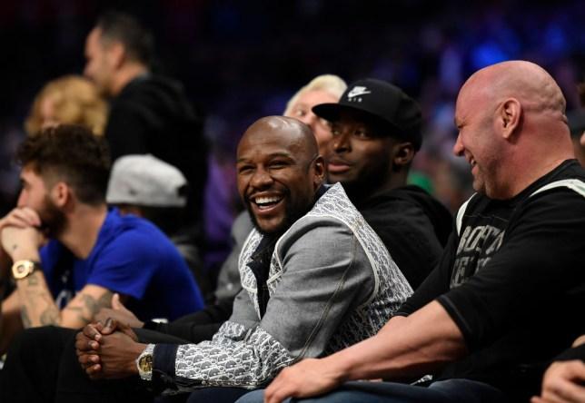 Floyd Mayweather laughs sitting alongside UFC boss Dana White