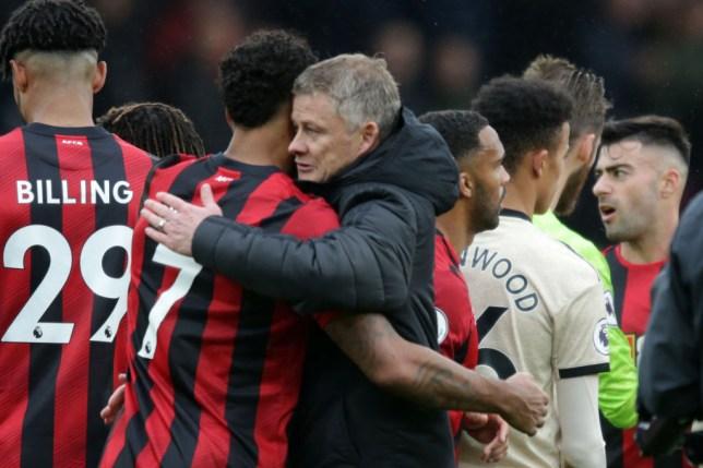 Ole Gunnar Solskjaer hugs Bournemouth striker Josh King