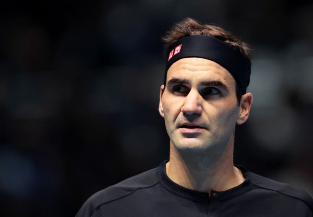 Roger Federer looks on during a tennis match