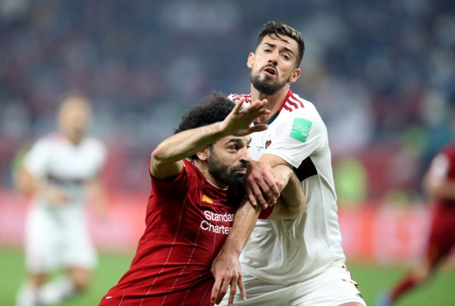 Pablo Mari wrestles with Mo Salah during a Liverpool game