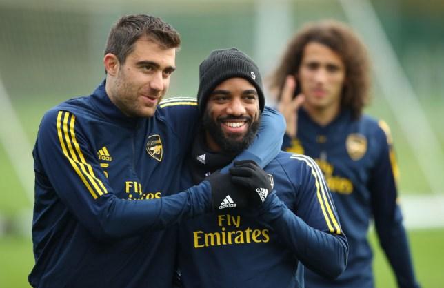Sokratis Papastathopoulos jokes with team mate Alexandre Lacazette during Arsenal training