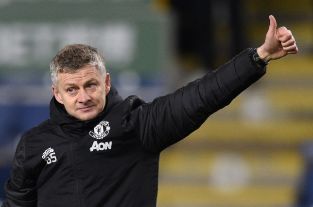 Manchester United manager Ole Gunnar Solskjaer gives a thumbs up to the crowd