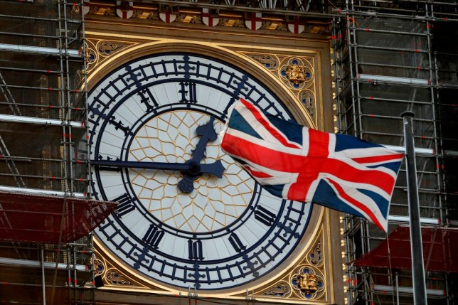 A union jack flag outside of the Big Ben, which is currently undergoing renovations