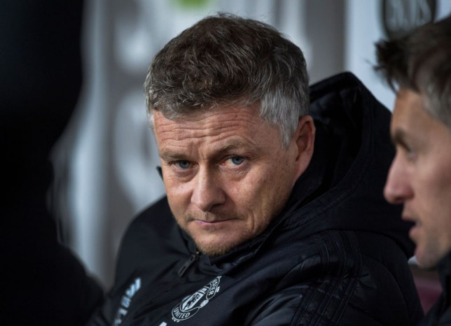 Ole Gunnar Solskjaer looks on from the Manchester United bench
