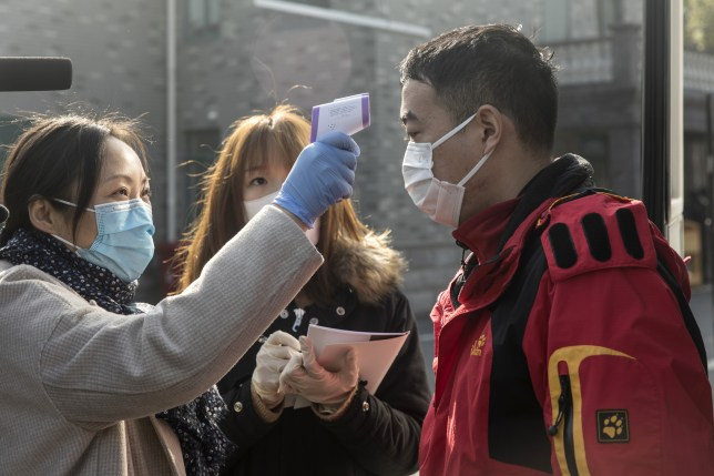 A member of the media has his temperature checked before proceeding to a tour of a factory operated by Dasheng Health Products Manufacturing Co.