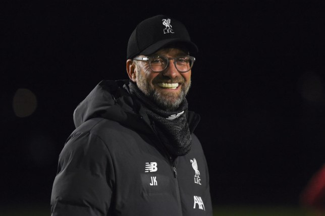 Jurgen Klopp smiles during Liverpool training