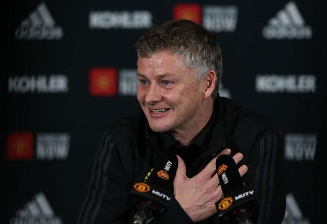 Manchester United boss Ole Gunnar Solskjaer smiles as he speaks to the press