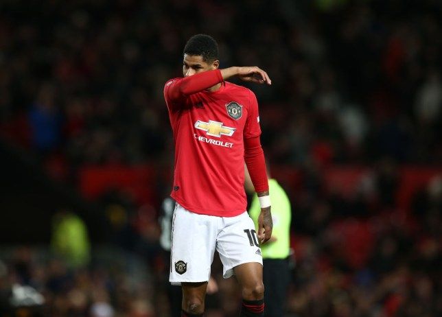 Manchester United forward Marcus Rashford leaves the pitch after injuring himself
