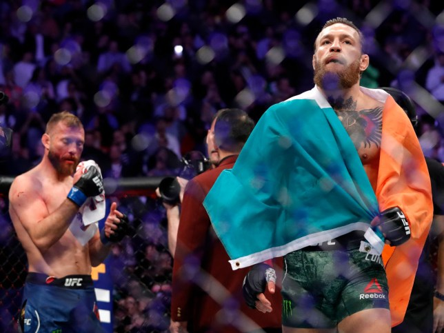 Conor McGrgeor struts away after stopping Donald Cerrone in their UFC fight