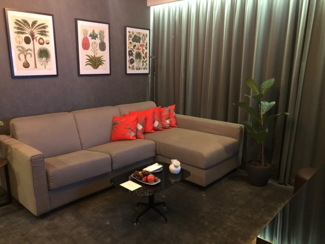 vegan hotel suite with pineapple leather pillows