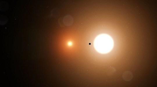 An artist's impression of TOI 1338 b orbiting its two parent stars (Nasa)