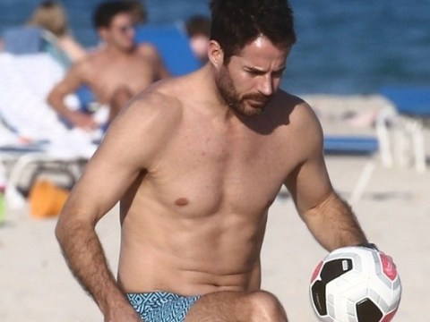 Jamie Redknapp proves he's still got football skills on beach day with sons Charley and Beau