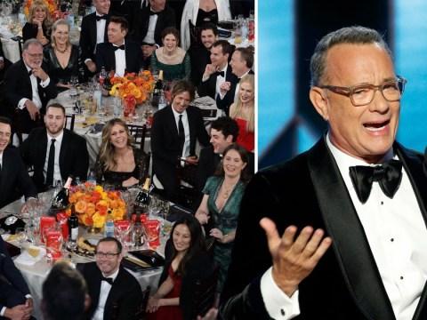 Tom Hanks holds back tears while giving moving speech during Golden Globes Awards