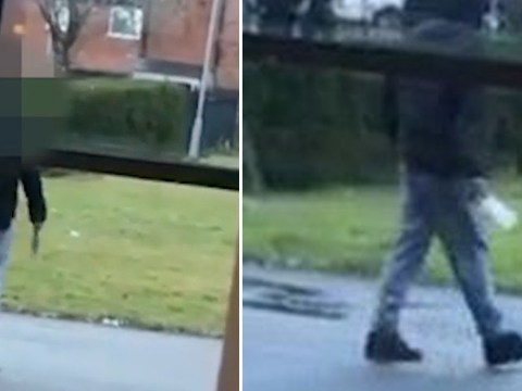 Terrifying footage shows man pacing outside school canteen with meat cleaver