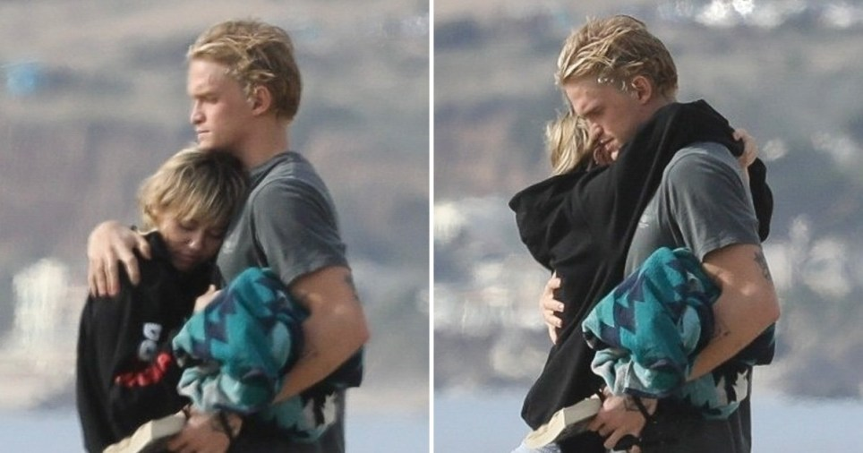 Cody Simpson has 'no complaints' over Miley Cyrus romance as they spend the day cuddling up at the beach