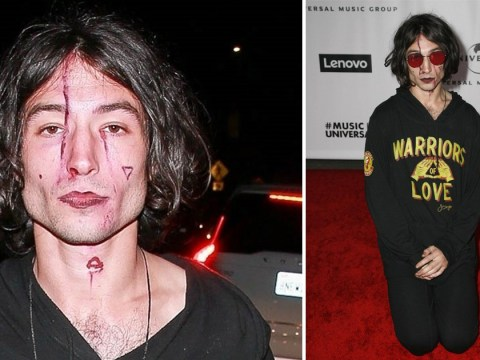 Ezra Miller bizarrely paints bloody scars onto his face for Grammys after party