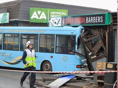 School bus with children on board crashes into barber's shop