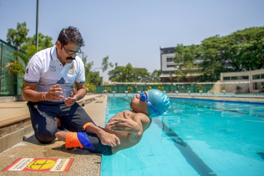 "KARNATAKA, SOUTH INDIA - MARCH 18 AND 19, 2019 - A 20-YEAR-OLD man who has broken over 300 bones has become an international swimming champion. Moin Junnedi was born with a rare condition called Osteogenesis Imperfecta - more commonly referred to as 'brittle bone disease' a rare genetic disorder characterised by bone fragility and vulnerability to bone fractures. But despite his bones being as fragile as glass, the student from Karnataka, has pursued a career in swimming. Moin told Barcroft TV: ""Before I started swimming, life was not good as much as today. I didn't have friends, nothing to do at home, just watch TV."" When Moin was born, his mother, Kouser, was told by doctors that her son only had three days to live. Kouser said: ""Ever since my son was born, I feel motivated. ""So many people have been inspired by his dedication and hard work."" Despite trying, Kouser couldn't enroll her son into a mainstream school or schools for people with disabilities, so she taught him at home. Moin's life transformed when a popular Paralympic swimming coach, Umesh Kalghatgi took him under his wing. Umesh said: ""I spotted Moin at a government event in 2009 and I immediately though that swimming might take his pain away. ""Since then Moin has been my star student and together we have garnered an international fame and reputation."" Due to his hard work, dedication and mum's support, Moin has won over 22 medals in various national and international Paralympic swimming championships. As well as swimming, Moin is also pursuing an undergraduate degree in commerce and economics at local university. PHOTOGRAPH BY: Shams Qari / Barcroft Media - NOTE: This Photo Can Only Be Used Within Context With The Information Provided In The Metadata (Photo credit should read Shams Qari / Barcroft Media via Getty Images)"