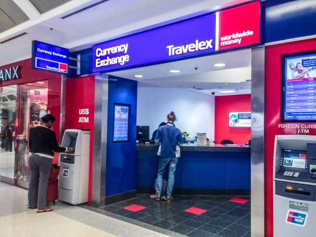Atlanta, USA - December 29, 2014: People using ATM and Currency Exchange at Atlanta Airport, USA