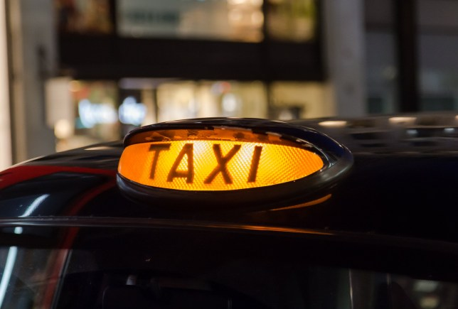 A closeup to a Taxi sign