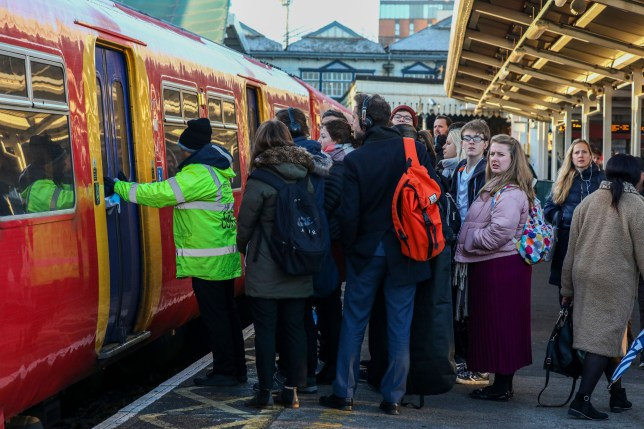 Mandatory Credit: Photo by Alex Lentati/LNP/REX (10489650v) Commuters queue on platforms on the first day of the South Western Railway strike at Clapham Junction. South Western Railway, RMT Strike, London, UK - 02 Dec 2019 RMT union have announced industrial action which will effect South Western Railway services for the next 27 days, until 02 January 2020.