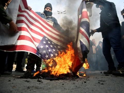 British flags burn in Iran as UK braces itself for revenge over Trump airstrike