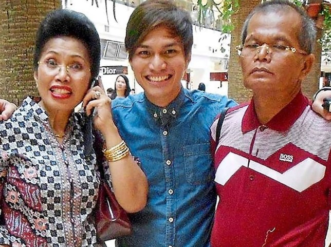 Sinaga with his parents