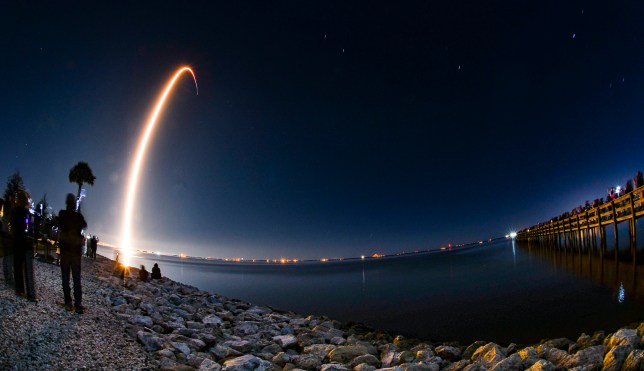 A SpaceX Falcon 9 rocket lifts off from Cape Canaveral Air Force Station, Fla., Monday evening, Jan. 6, 2020, as viewed in a time exposure from KARS Park on Merritt Island. (Malcolm Denemark/Florida Today via AP)