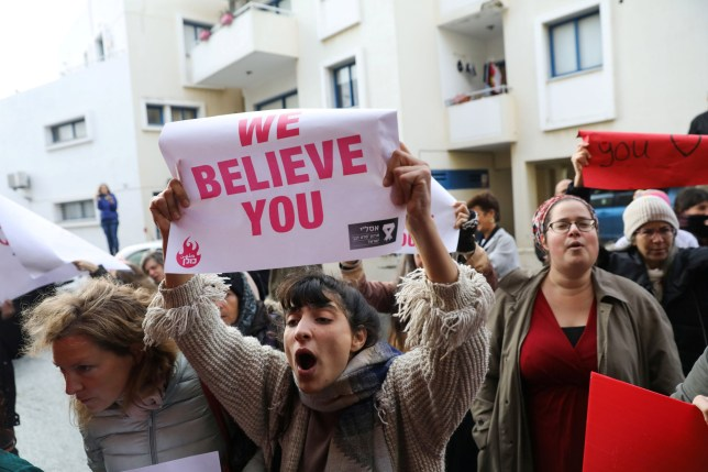 Activists demonstrating after a British woman was found guilty of faking a rape claim