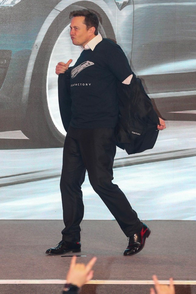 "Tesla CEO Elon Musk dances during the Tesla China-made Model 3 Delivery Ceremony in Shanghai. - Tesla CEO Elon Musk presented the first batch of made-in-China cars to ordinary buyers on January 7, 2020 in a milestone for the company's new Shanghai ""giga-factory"", but which comes as sales decelerate in the world's largest electric-vehicle market. (Photo by STR / AFP) / China OUT (Photo by STR/AFP via Getty Images)"