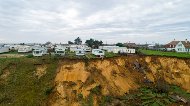 Picture supplied by Terry Harris/Bav Media 07976 880732. Picture dated January 7th shows seaside caravans that have been left precariously balanced on the edge of a cliff after a dramatic landslide in Trimingham ,North Norfolk. Seaside caravans have been left precariously balanced on the edge of a cliff after a dramatic landslide the size of two football pitches in North Norfolk. Only one of the caravans at Trimingham House Caravan Park, about five miles east of Cromer, was being used and the woman and her child were led to safety following the cliff fall in the early hours of yesterday morning (Mon). Tony Garbutt, coastguard sector commander in north Norfolk, said: ???There was only one person who was occupying a caravan who was in danger and she was removed safely with her child SEE COPY CATCHLINE Caravans balanced after dramatic landslide