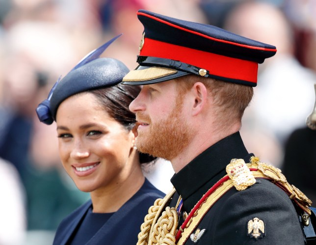 LONDON, UNITED KINGDOM - JUNE 08: (EMBARGOED FOR PUBLICATION IN UK NEWSPAPERS UNTIL 24 HOURS AFTER CREATE DATE AND TIME) Meghan, Duchess of Sussex and Prince Harry, Duke of Sussex travel down The Mall in a horse drawn carriage during Trooping The Colour, the Queen's annual birthday parade, on June 8, 2019 in London, England. The annual ceremony involving over 1400 guardsmen and cavalry, is believed to have first been performed during the reign of King Charles II. The parade marks the official birthday of the Sovereign, although the Queen's actual birthday is on April 21st. (Photo by Max Mumby/Indigo/Getty Images)