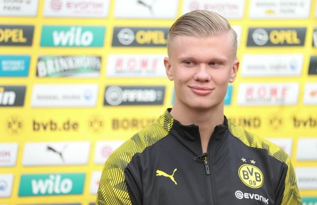 Borussia Dortmund striker Erling Haaland smirks during a press conference