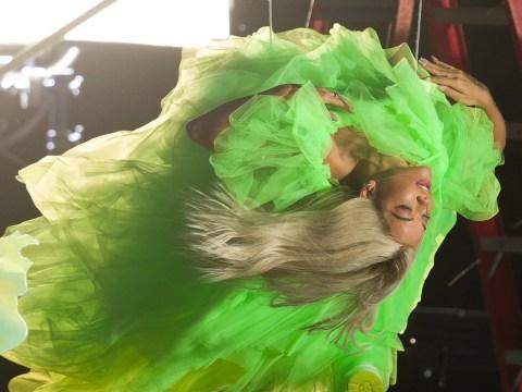 Rita Ora swings upside down and rocks billowy yellow dress for photoshoot in Miami