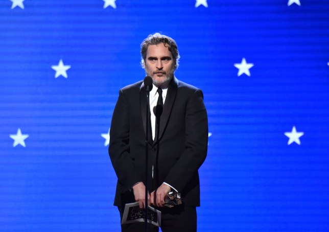SANTA MONICA, CALIFORNIA - JANUARY 12: Joaquin Phoenix accepts the Best Actor award for 'Joker' onstage during the 25th Annual Critics' Choice Awards at Barker Hangar on January 12, 2020 in Santa Monica, California. (Photo by Jeff Kravitz/FilmMagic)