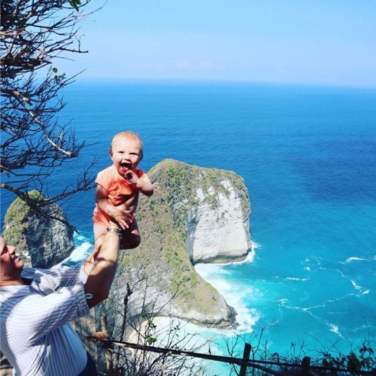 Baby George Farrat Nusa Penida in Bali, the world's best-travelled BABY - after his mum and dad split their parental leave and used it to travel the globe. See SWNS story SWSYmaternity; Samantha Farr, 31, and husband Jonathan, 37, decided they were going to embark on their adventure when pregnant with George, now one. The teachers started planning just two weeks after he arrived in January 2019 and saved up, before splitting Samantha's maternity leave. Alongside older kids Archie, seven, and Teddy, three, they embarked on a three-month backpacking trip across eight countries and through twelve cities. They walked parts of the Great Wall of China and paddled over the Great Barrier Reef, surfed the Gold Coast and roamed the deserts of Dubai. They abandoned hopes of any sort of newborn routine, dealing with the sleepless nights in 19 different places, from hotels and tents to camper vans and hotels, rather than their home in Louth, Lincolnshire. Now back in the UK, the adventurous family are already missing the freedom and would urge others to follow in their footsteps next year.