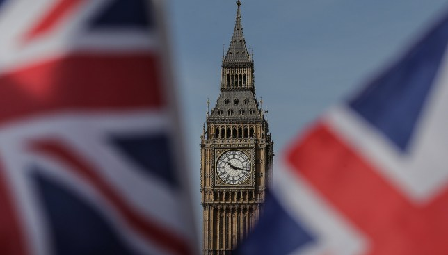 Union flags fly near the houses of parliament