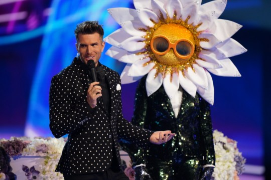 This image is strictly embargoed until 00.01 Frisday 17th January 2020 From Bandicoot TV The Masked Singer: Ep4 on ITV Pictured: Joel Dommett and Daisy. This photograph is (C) Bandicoot TV and can only be reproduced for editorial purposes directly in connection with the programme or event mentioned above, or ITV plc. Once made available by ITV plc Picture Desk, this photograph can be reproduced once only up until the transmission [TX] date and no reproduction fee will be charged. Any subsequent usage may incur a fee. This photograph must not be manipulated [excluding basic cropping] in a manner which alters the visual appearance of the person photographed deemed detrimental or inappropriate by ITV plc Picture Desk. This photograph must not be syndicated to any other company, publication or website, or permanently archived, without the express written permission of ITV Picture Desk. Full Terms and conditions are available on the website www.itv.com/presscentre/itvpictures/terms For further information please contact: james.hilder@itv.com / 0207 157 3052