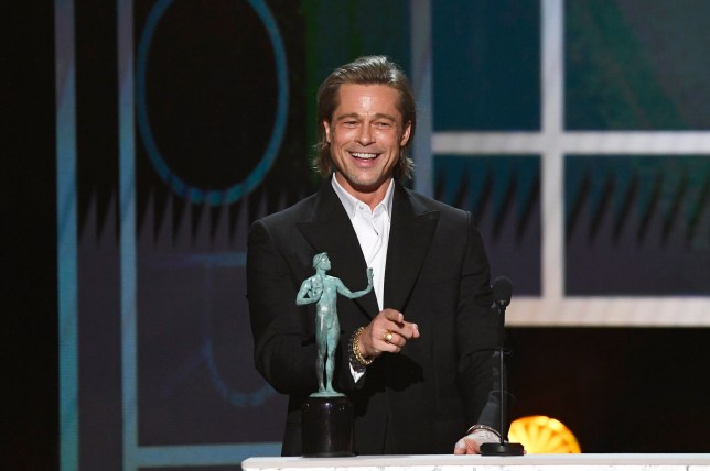 LOS ANGELES, CALIFORNIA - JANUARY 19: Brad Pitt accepts Outstanding Performance by a Male Actor in a Supporting Role for 'Once Upon a Time in Hollywood' onstage during the 26th Annual Screen Actors??Guild Awards at The Shrine Auditorium on January 19, 2020 in Los Angeles, California. 721359 (Photo by Kevork Djansezian/Getty Images for Turner)