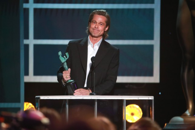 """LOS ANGELES, CALIFORNIA - JANUARY 19: Brad Pitt accepts the awards for Outstanding Performance by a Male Actor in a Supporting Role for """"Once Upon A Time In Hollywood"""" onstage during the 26th Annual Screen Actors??Guild Awards at The Shrine Auditorium on January 19, 2020 in Los Angeles, California. (Photo by Rich Fury/Getty Images)"""