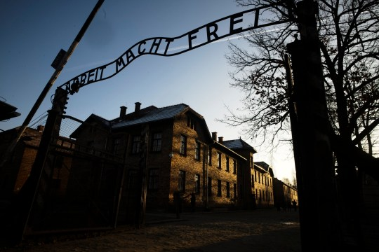 CAPTION CORRECTION: CORRECTS COUNTRY: FILE - In this Dec. 6, 2019, file photo, the sun lights the buildings behind the entrance of the former Nazi death camp of Auschwitz-Birkenau in Oswiecim, Poland. World leaders will gather twice to mark the 75th anniversary of the liberation of the Auschwitz-Birkenau concentration camp _ once on Thursday, Jan. 23, 2020, in Jerusalem and again on Jan. 27 at the Auschwitz site in southern Poland. The fact that there will be two competing ceremonies reflects how politically charged World War II remains for nationalist governments in Russia and Poland. (Photo/Markus Schreiber, File)