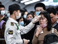 """GUAGZHOU, CHINA - JANUARY 22: Citizens wear masks to defend against new viruses on January 22,2020 in Guangzhou, China.The 2019 new coronavirus, known as """"2019-nCoV"""", was discovered in Wuhan virus pneumonia cases in 2019, and the virus was transmitted from person to person. Currently, confirmed cases have been received in various parts of the world. (Photo by Stringer/Anadolu Agency via Getty Images)"""