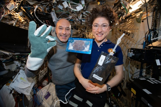 Undated handout photo issued by NASA of ISS commander Luca Parmitano and astronaut Christina Koch with milk and cookies on board the International Space Station (ISS), as chocolate chip cookies have become the first food to be baked in space. PA Photo. Issue date: Thursday January 23, 2020. See PA story SCIENCE Cookies. Photo credit should read: NASA/PA Wire NOTE TO EDITORS: This handout photo may only be used in for editorial reporting purposes for the contemporaneous illustration of events, things or the people in the image or facts mentioned in the caption. Reuse of the picture may require further permission from the copyright holder.