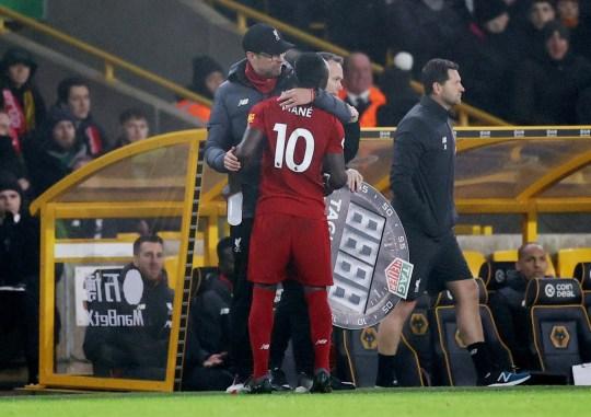 Liverpool forward Sadio Mane is hugged by Jurgen Klopp as he goes off injured