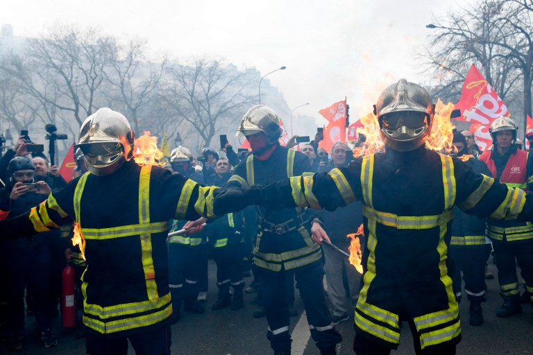 Firefighters set themselves alight as they take part in a demonstration to protest against French government's plan to overhaul the country's retirement system in Paris, on January 28, 2020. (Photo by Bertrand GUAY / AFP) (Photo by BERTRAND GUAY/AFP via Getty Images)