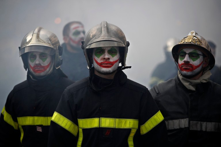 epaselect epa08172732 Some firefighters with their face painted with the movie character 'Joker' theme, participate in a demonstration against the pension reforms and for better work conditions in Paris, France, 28 January 2020. French government is facing weeks of consecutive general strike and demonstration to protest against their future reform of the pension system. EPA/YOAN VALAT