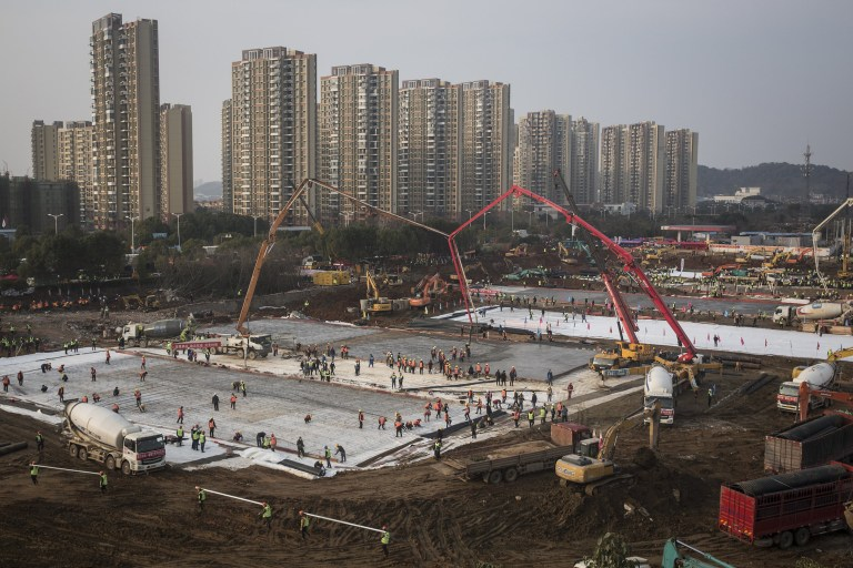WUHAN, CHINA - JANUARY 28: (CHINA OUT) Hundreds of construction workers and heavy machinery build new hospitals to tackle the coronavirus on January 28, 2020 in Wuhan, China. Wuhan Huoshenshan hospital will be completed on February 2nd and put into use on February 5th, with the capacity of 1000 beds. (Photo by Getty Images) *** BESTPIX ***