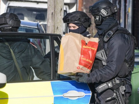 Armed police try to coax gunman out with McDonald's breakfast
